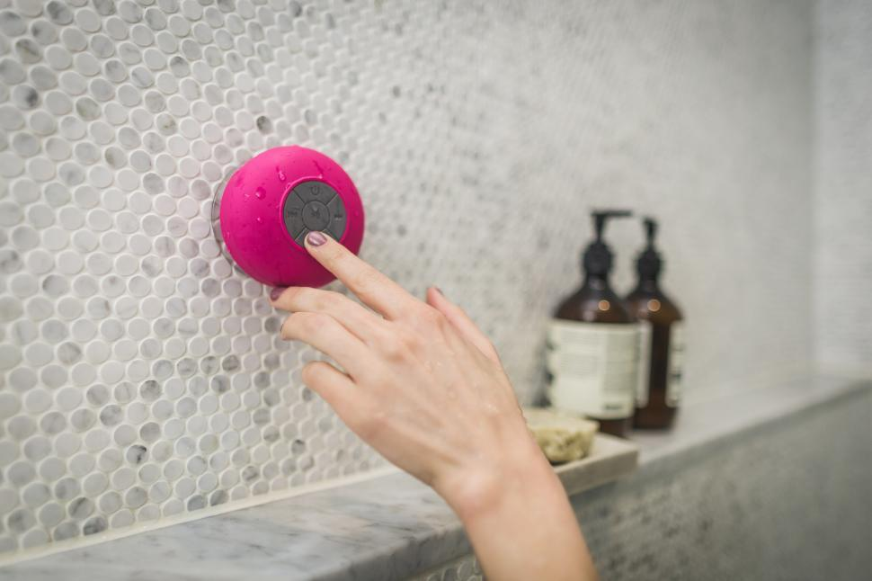 Download Free Stock HD Photo of Woman Using Shower Speaker Online