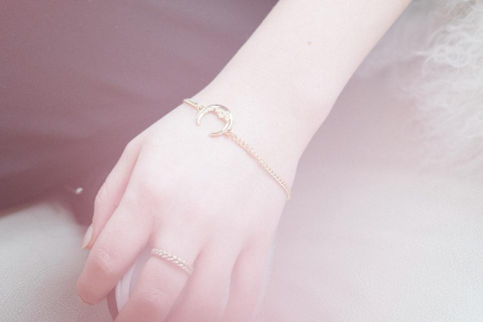 Download Free Stock HD Photo of Woman s Hand With Charm Bracelet Online
