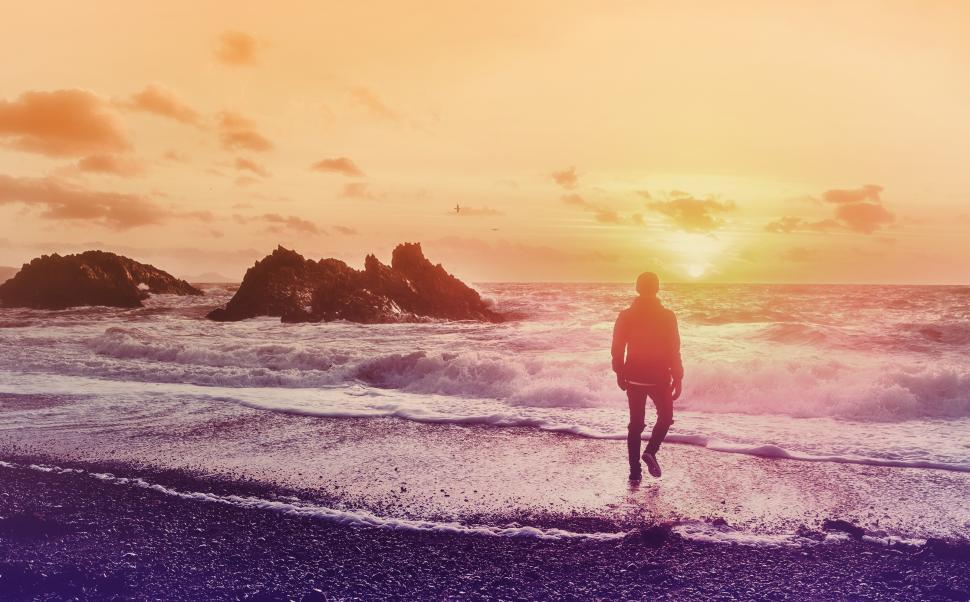 Download Free Stock Photo of Into the Sea - Young Man Watching the Sunrise at the Beach