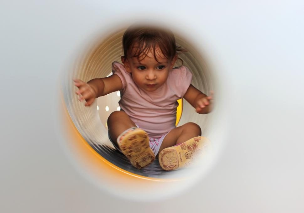 Download Free Stock HD Photo of Little Child Playing Inside Tube Playground Online