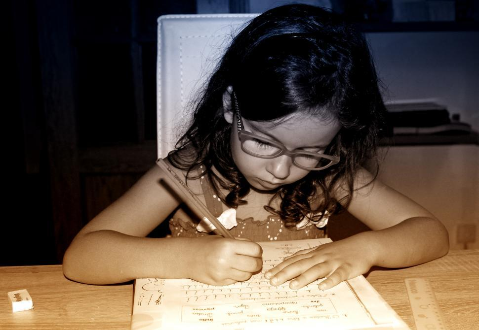 Download Free Stock Photo of Little Girl Doing Homework