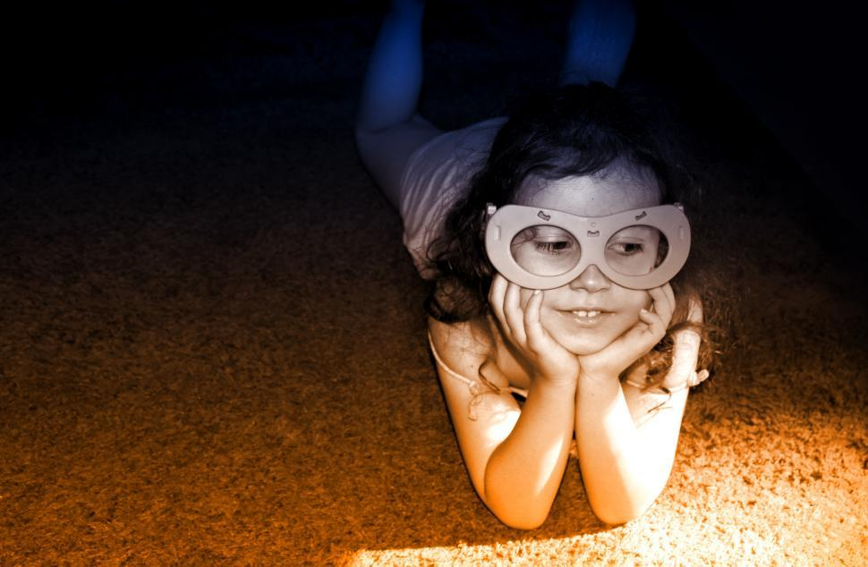 Download Free Stock HD Photo of Little Girl Having Fun Wearing a Mask Online