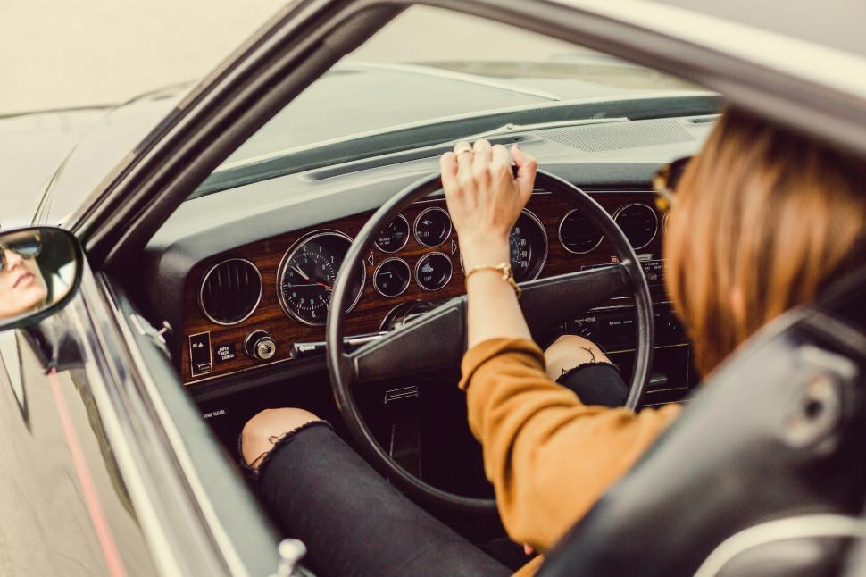 Download Free Stock HD Photo of Woman In Vintage Car Online