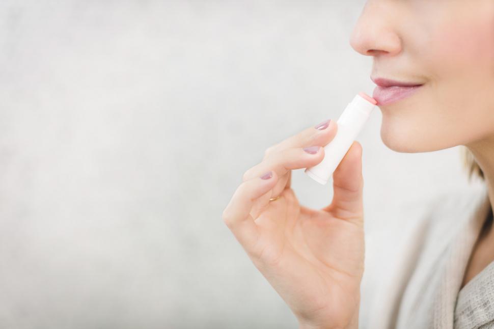 Download Free Stock HD Photo of Woman Using Pale Lip Balm Online
