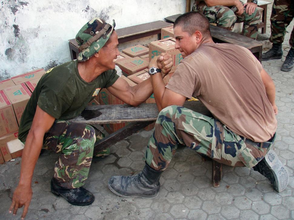 Download Free Stock Photo of assault rifle automatic firearm automatic rifle man machine gun autoloader soldier serviceman male stretcher person