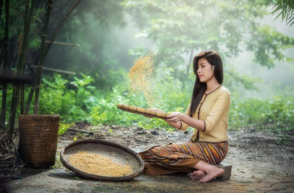Download Free Stock HD Photo of Lonely Girl Cleaning Rice Online