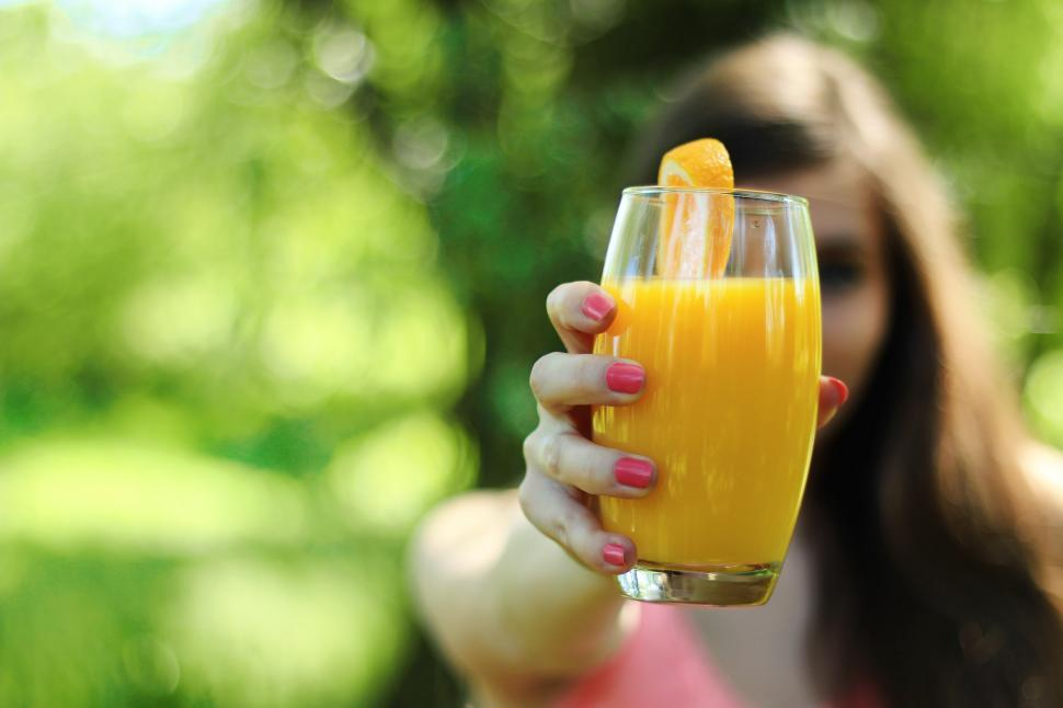 Download Free Stock Photo of Girl Offering Juice