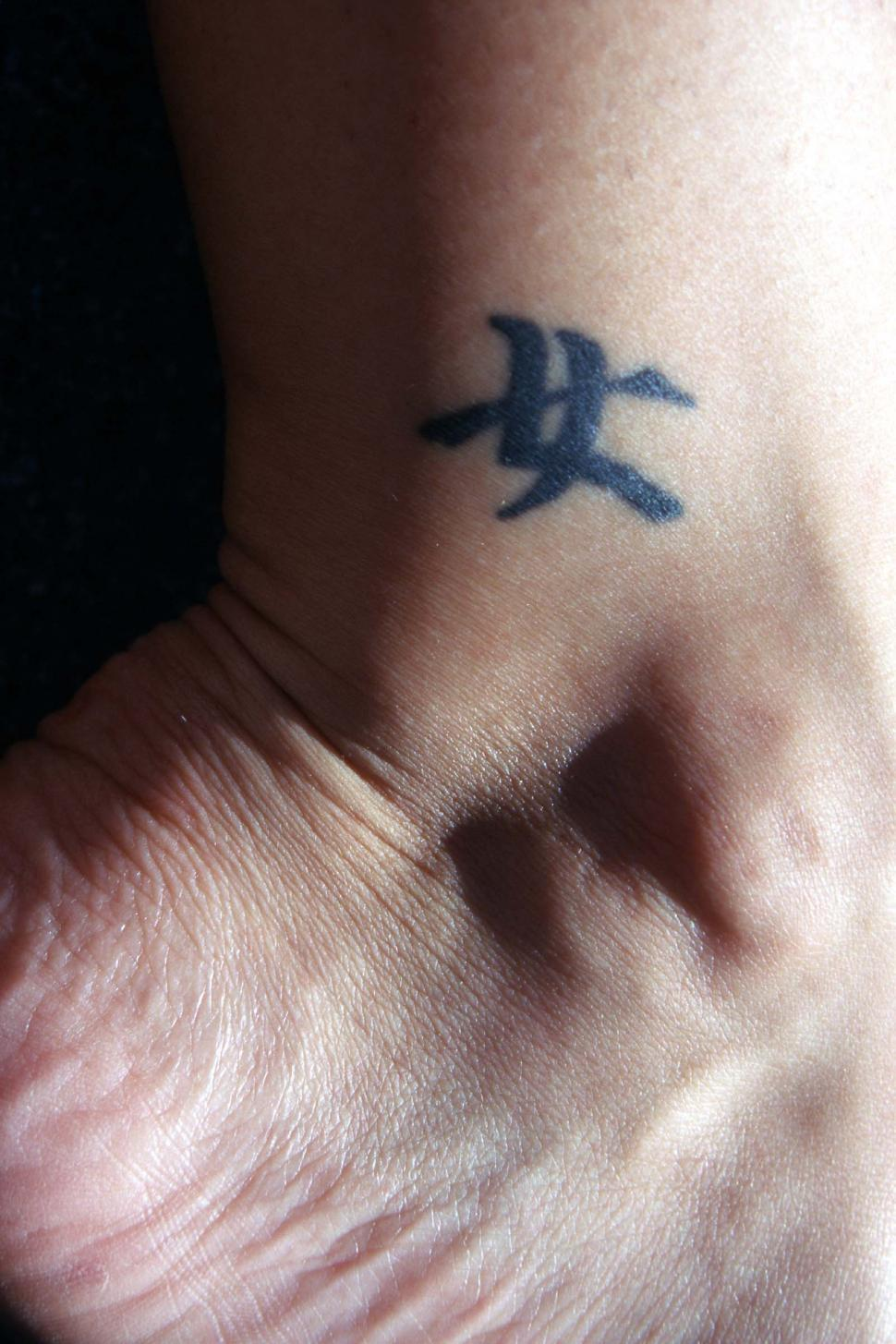 Download Free Stock Photo of Ankle tattoo