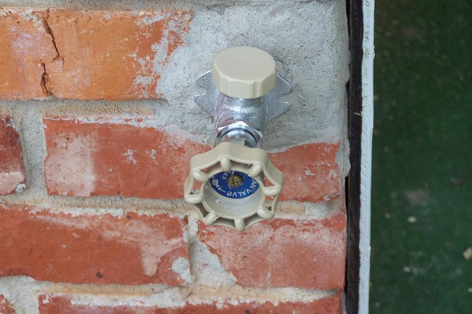 Download Free Stock HD Photo of Outdoor Water Faucet on Brick Online