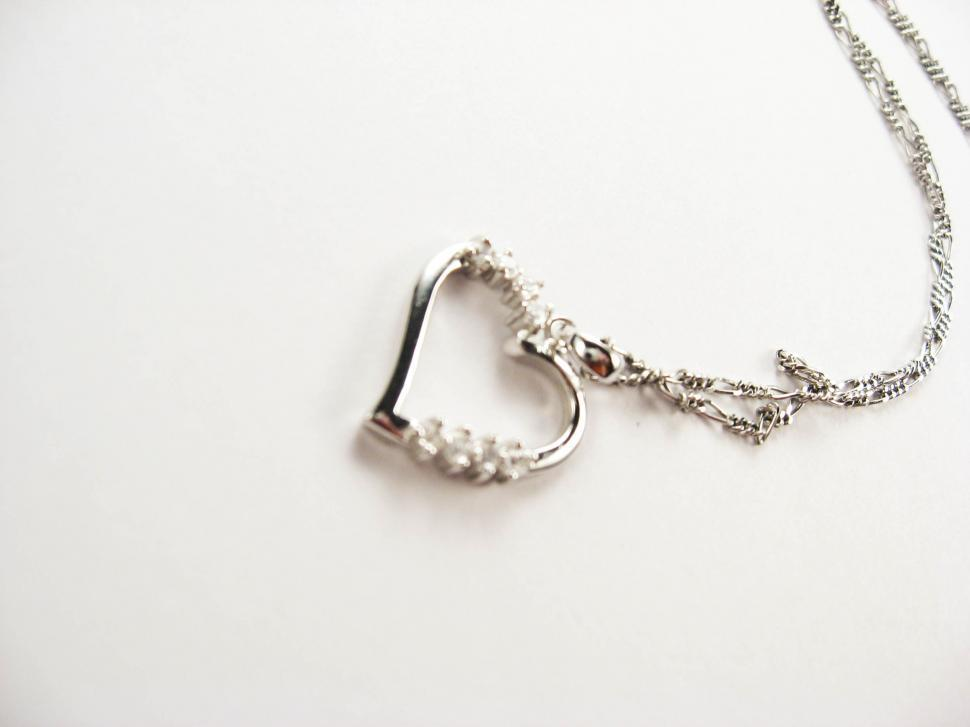 Download Free Stock HD Photo of heart on silver necklace Online