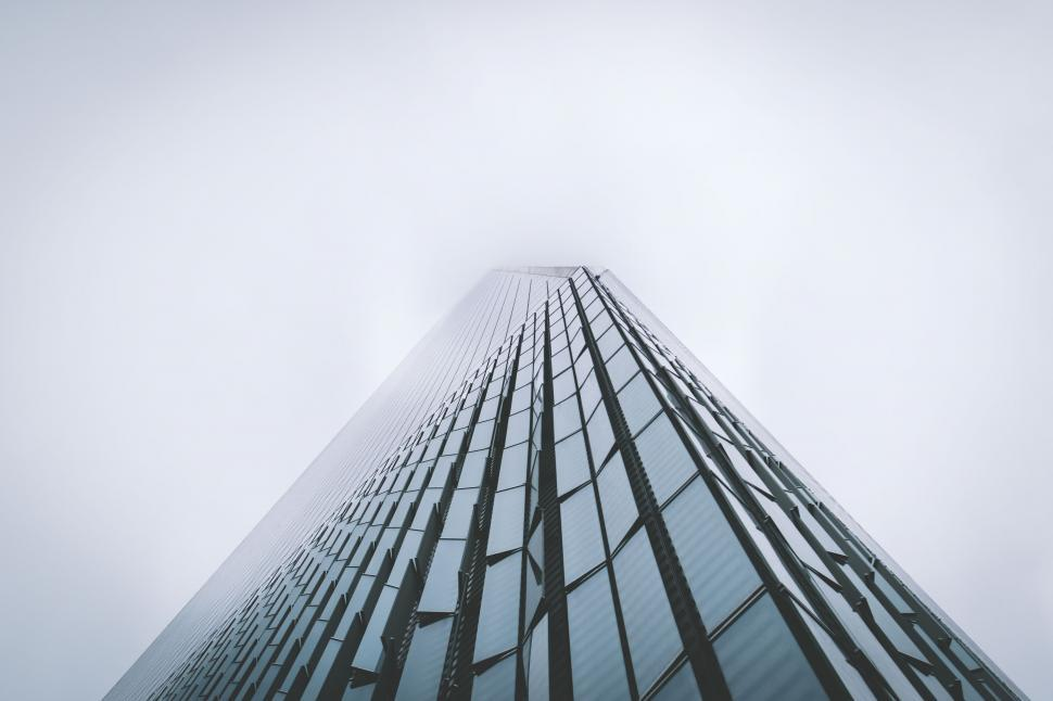 Download Free Stock Photo of skyscraper architecture city building tower urban bridge structure modern sky construction office tall business downtown glass corporate steel new futuristic financial exterior high landmark district reflection window finance perspective
